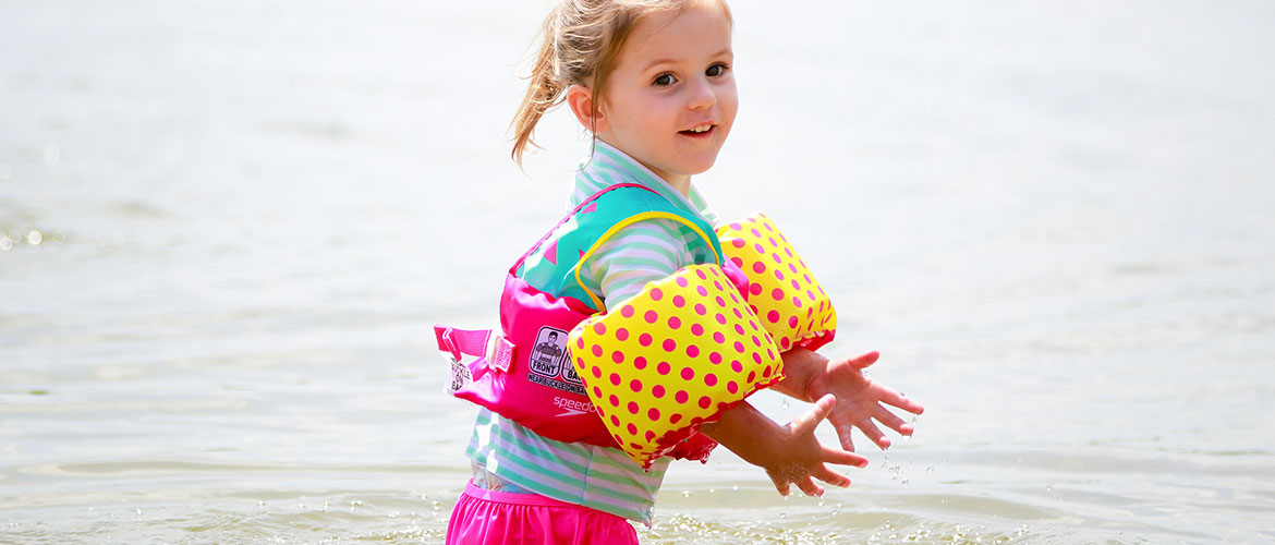 Girl playing in Lake